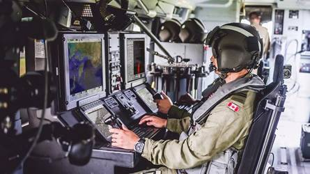 Member of the Canadian Armed Forces at console.